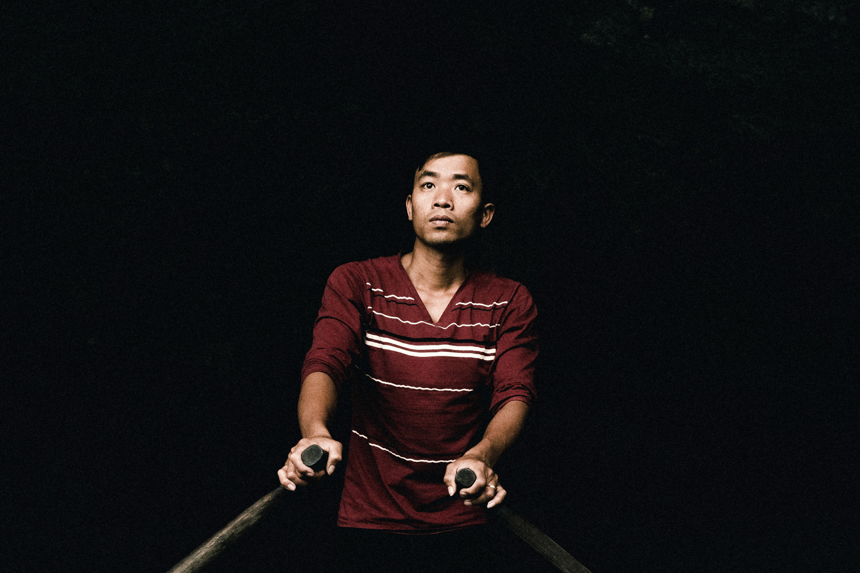 A man rows through a karst rock cave.