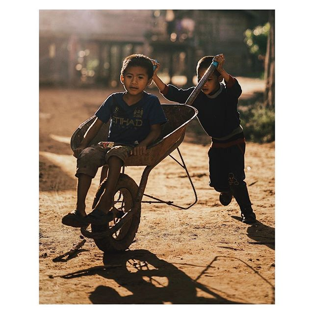 Two young children playing in a remote village in Laos. Getting to spend the night here whilst midway trekking through the jungle was amazing. The warmth and kindness from the locals will always be remembered.
