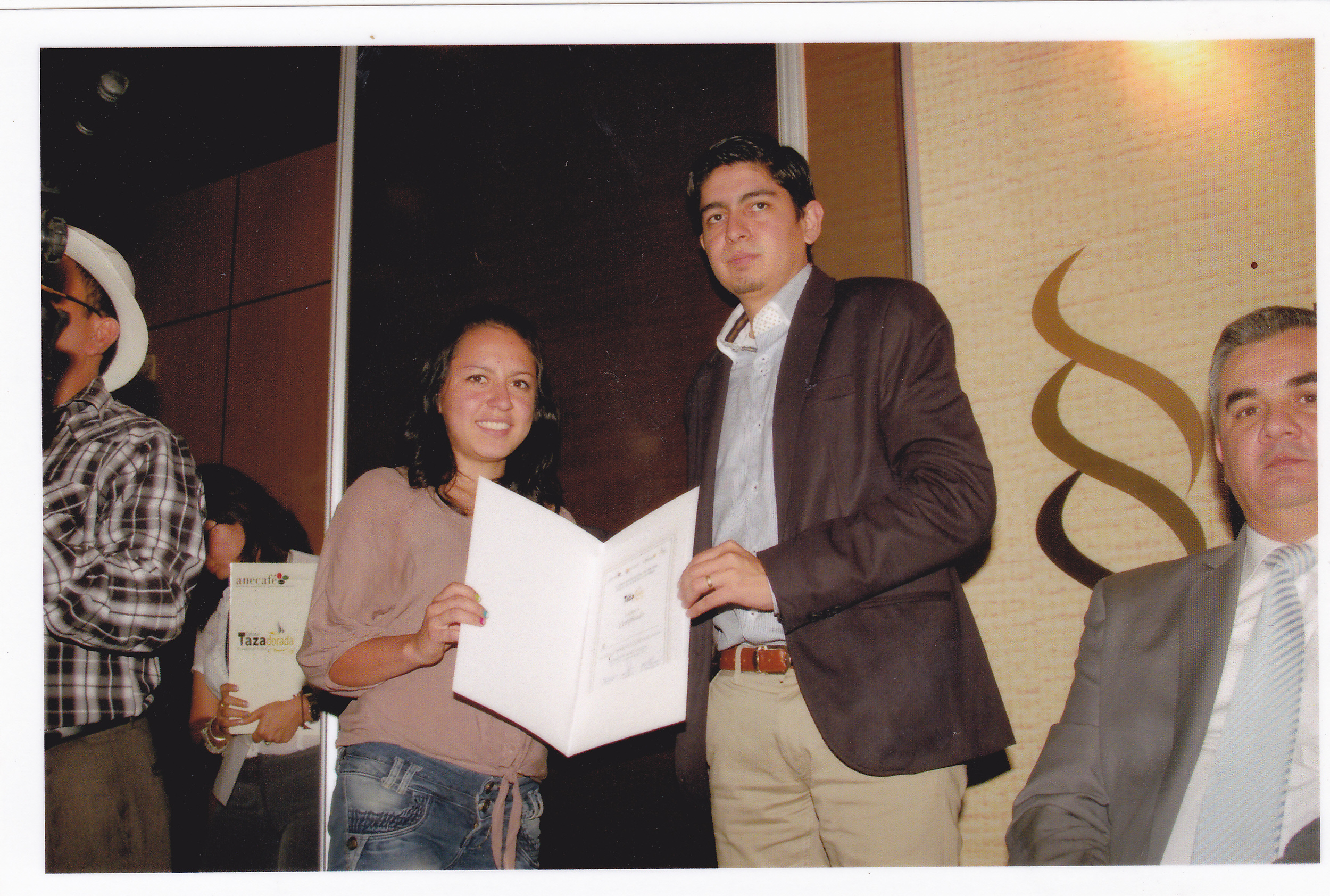 Angelino Abad's oldest daughter, Catherine, receiving ACOPOC's award in the 2013 Taza Dorada (Gold Cup) competition.