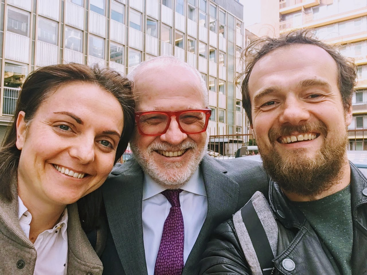 Happy faces after deciding to work together in April 2017, outside the ARC office in Milan, Italy.