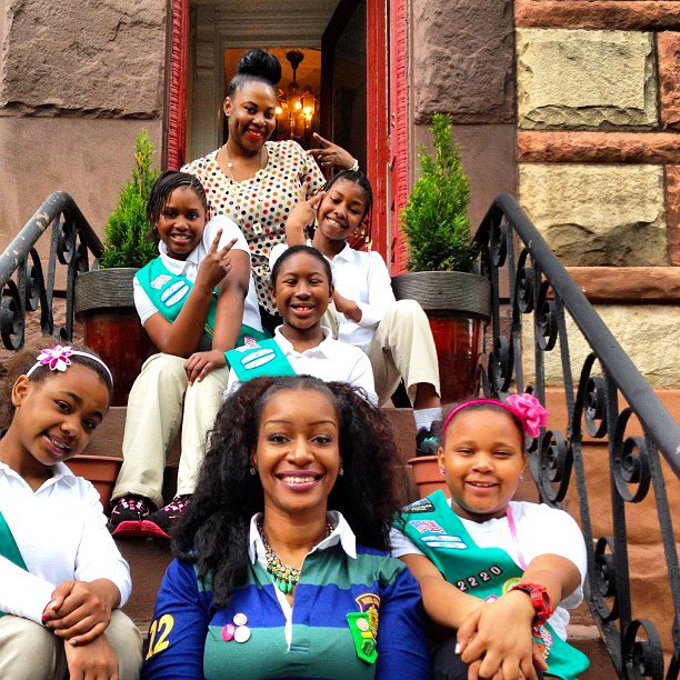 Emicia poses with her Girl Scouts.