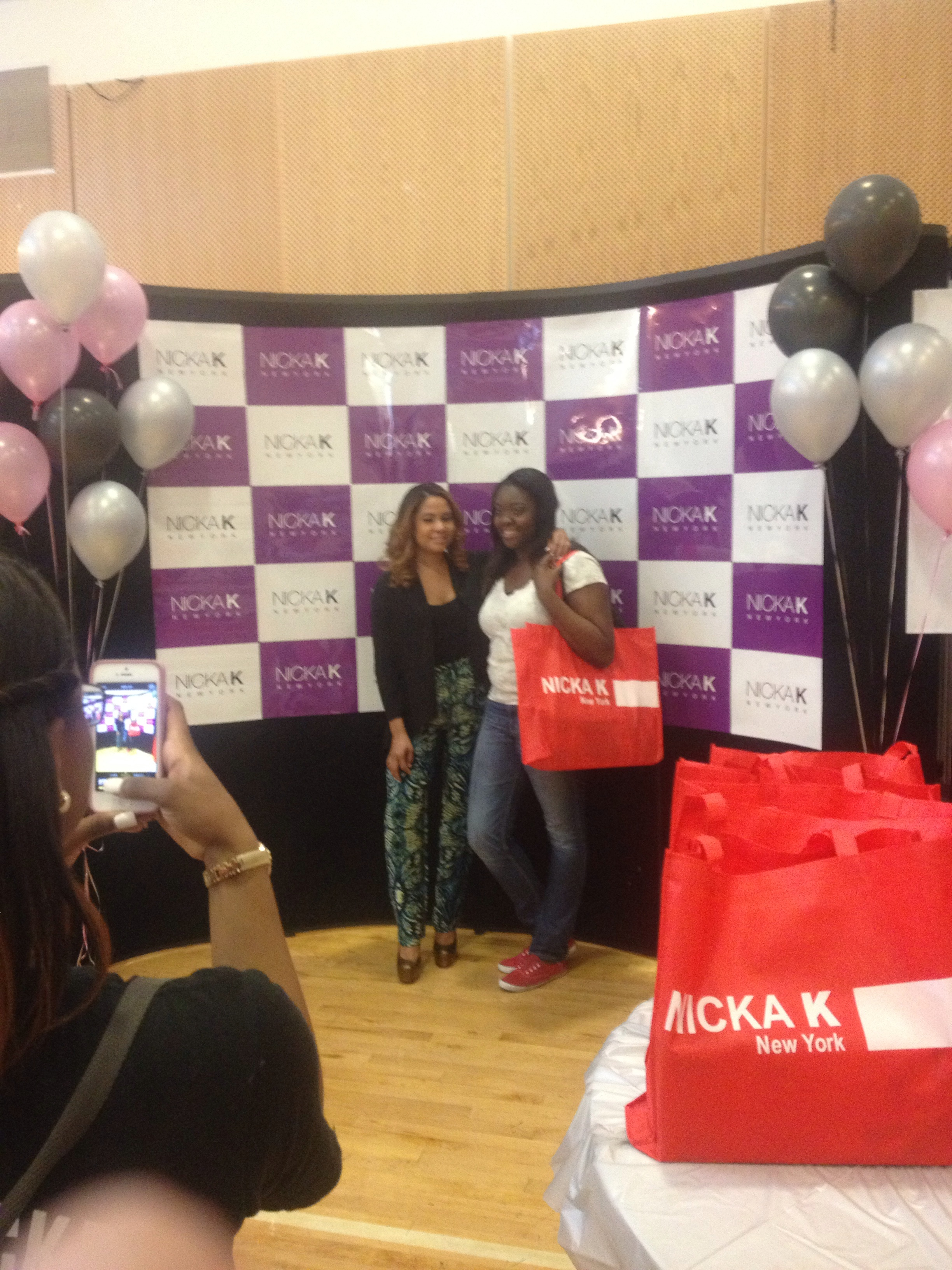 (Angela Yee poses with an honoree over at the Nika K section)