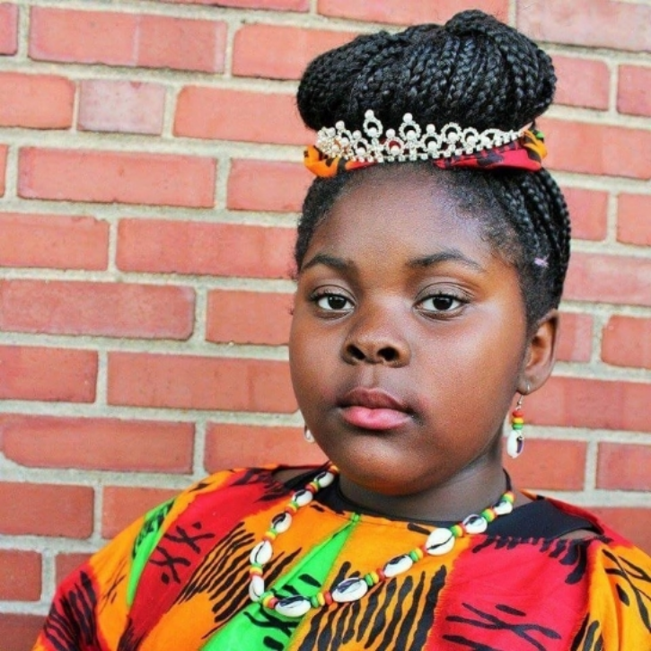"10 year old Princess Egypt 'Ify' Ufele wearing her crown. She said ""No more!"" to being bullied."