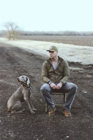 Co-owner Travis and his dog, Delilah.