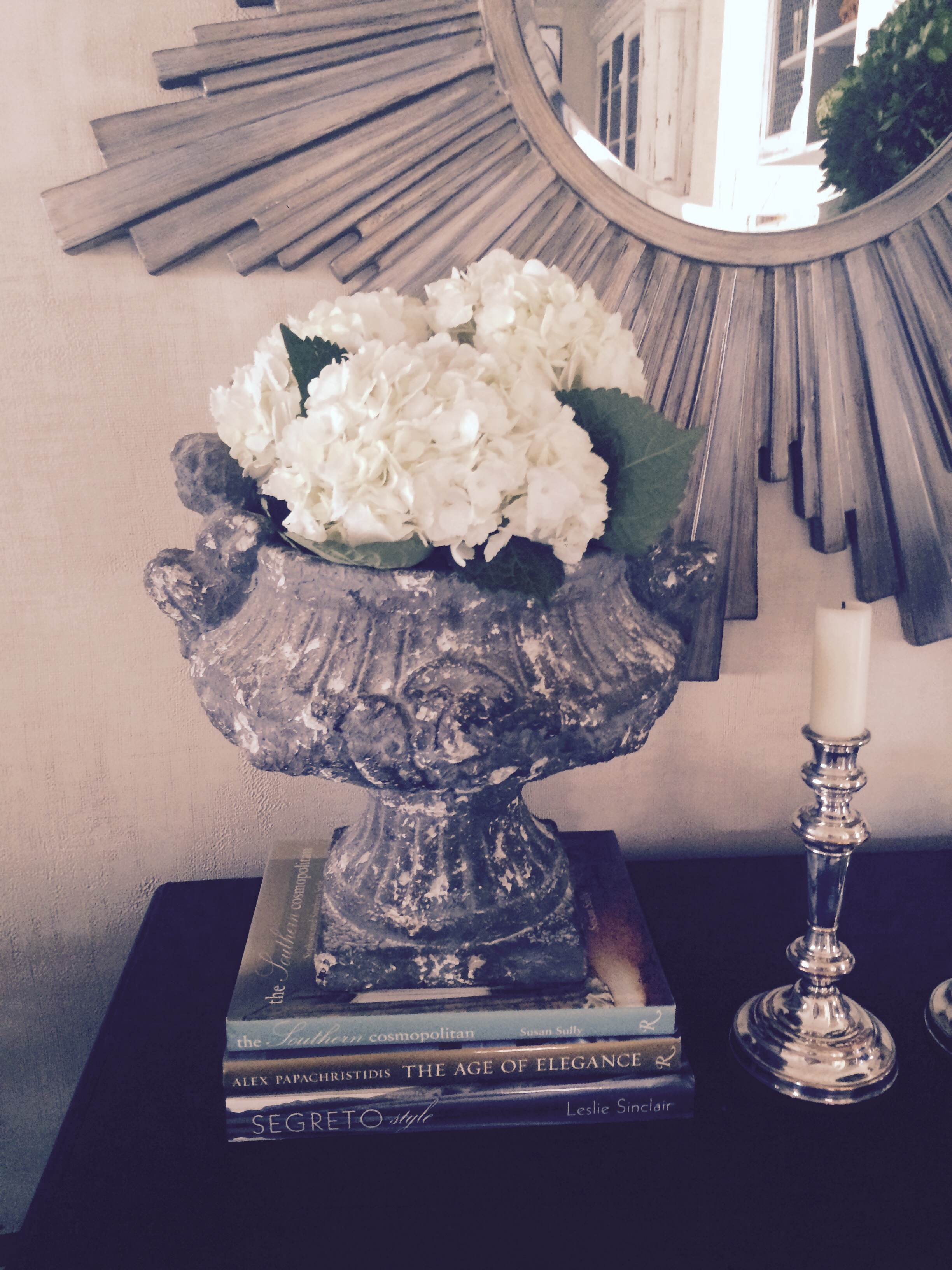Fresh hydrangeas look great in an urn in our designer Cathy's living room.  She placed the hydrangeas in a mason jar and tucked the mason jar inside the urn, viola!