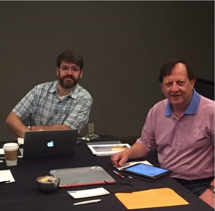 Polishing a vital presentation for our company's annual leadership meeting with Sandy Schwartz, the president of our company.
