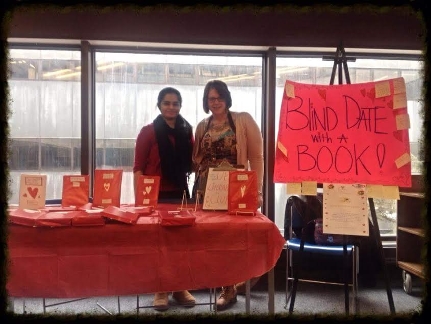 """UB Lit Club's """"Blind Date with a Book"""" event, 2013  Left: Athira Unni; Right: Heather Cook; Photo Credit: Anne Mulrooney"""
