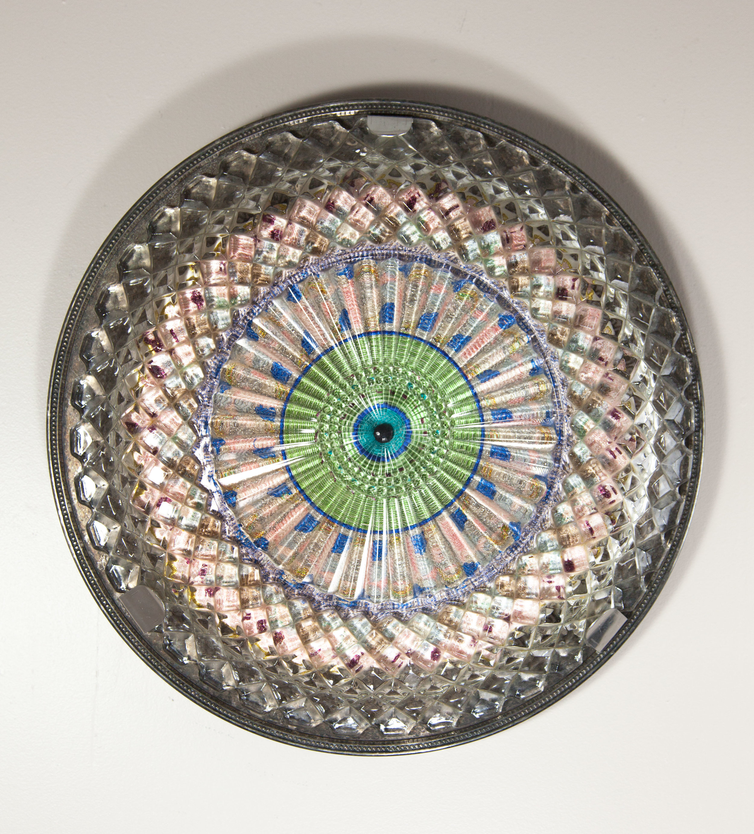 Good Looking, 2017 Domestic objects, fabric, machine embroidery, plastic button, stainless steel, monofilament, 15 1/2 x 15 1/2 x 2 1/2 inches