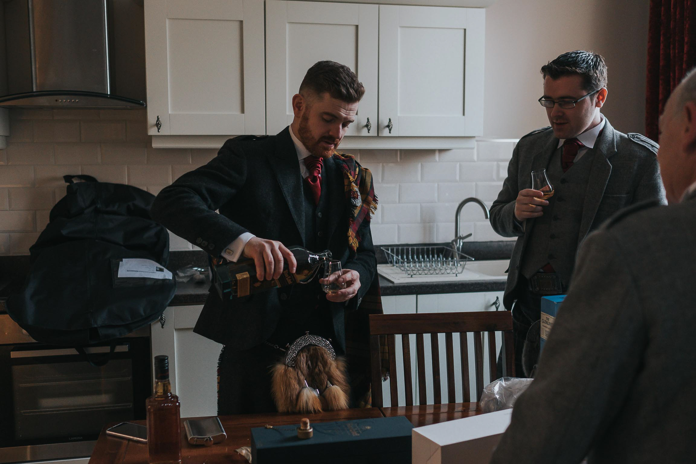 the groom pouring single malt from himself and best man at the Middleton hotel, liverpool