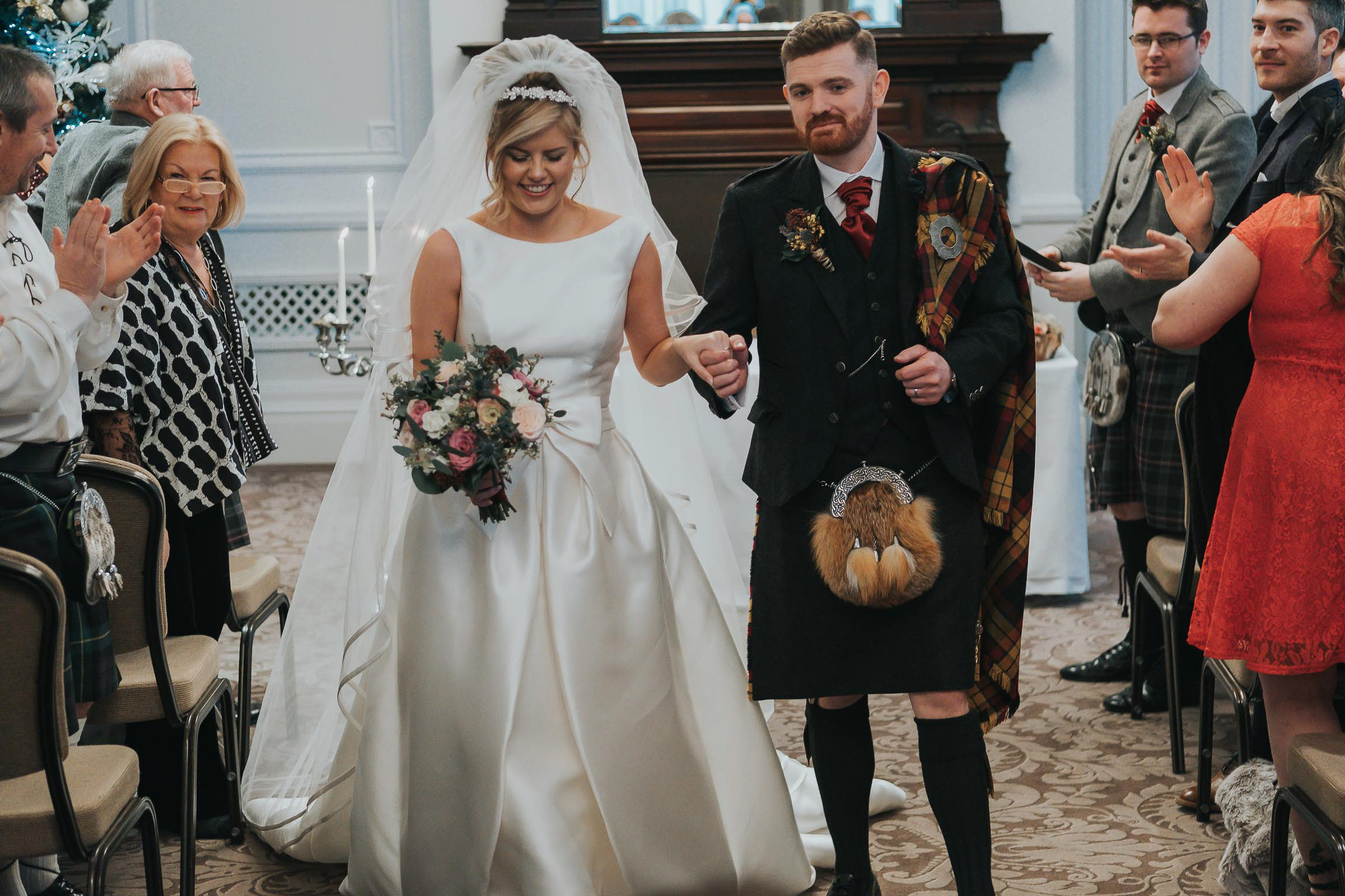 bride and groom walking down the aisle after becoming man and wife