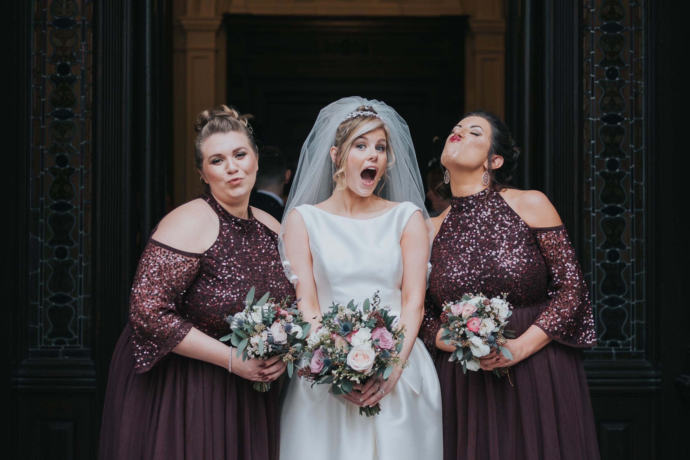 the bride and bridesmaids during their wedding day making funny faces