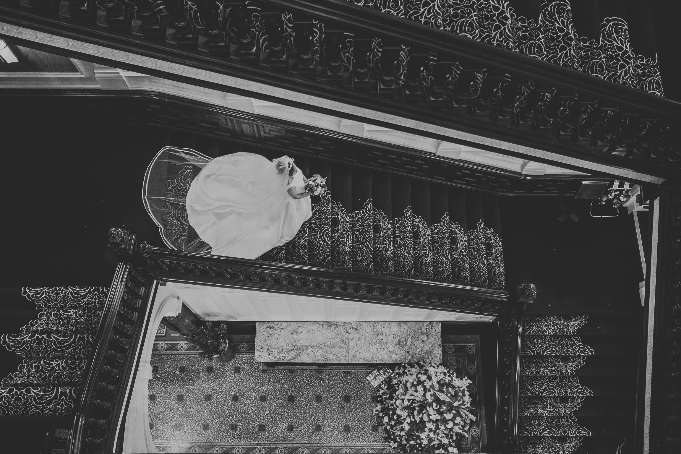 stunning bride in her wedding dress on the stairs in the Double Tree by Hilton Liverpool