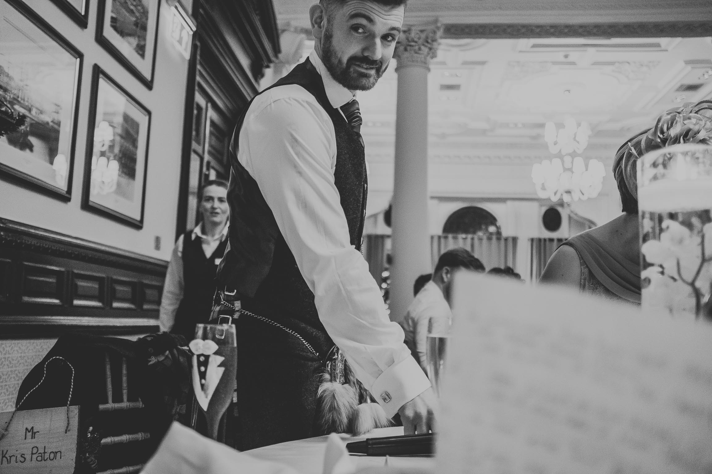 black and white image groom preparing for his grooms speech