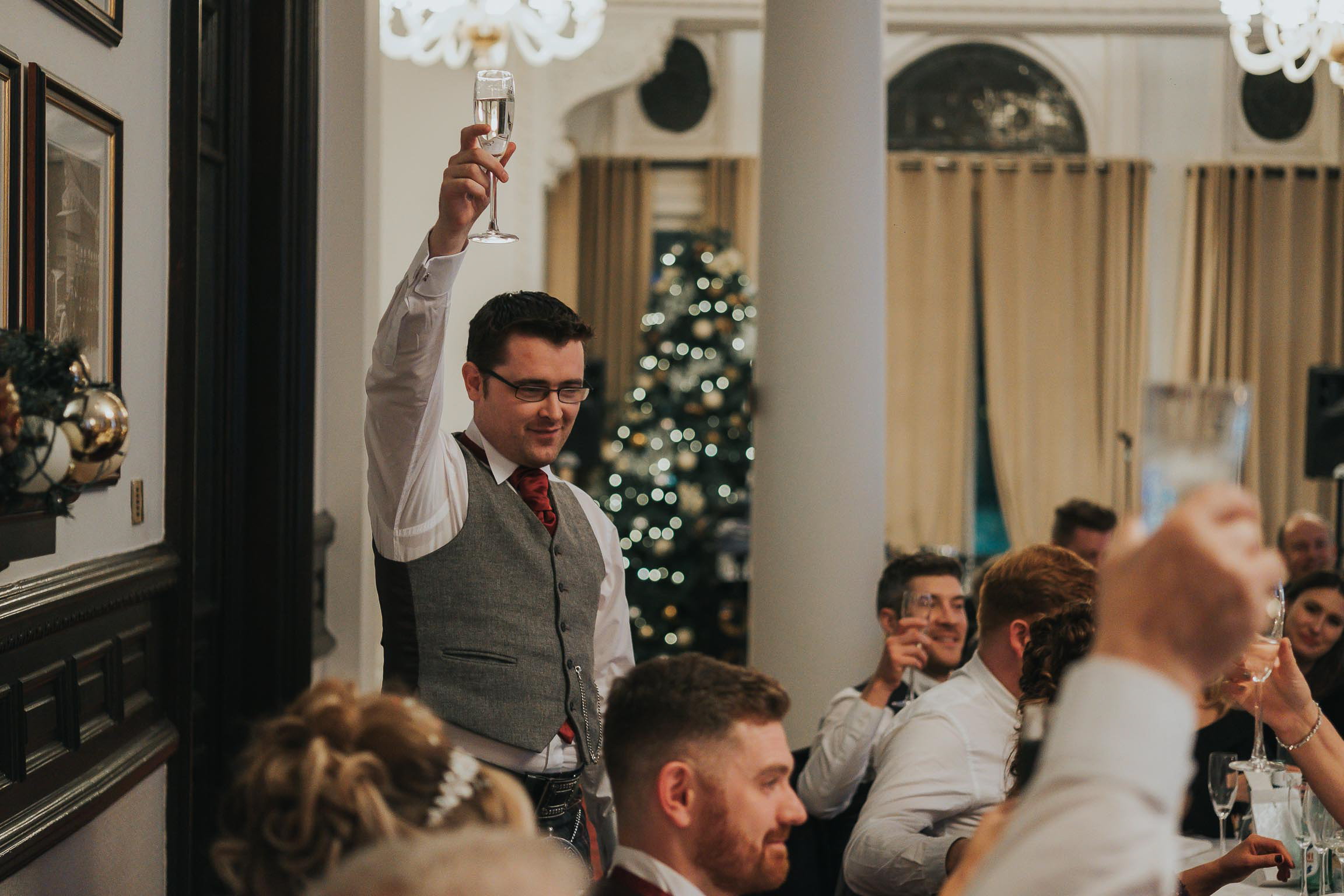 the best man toasts the happy couple during his best mans speech