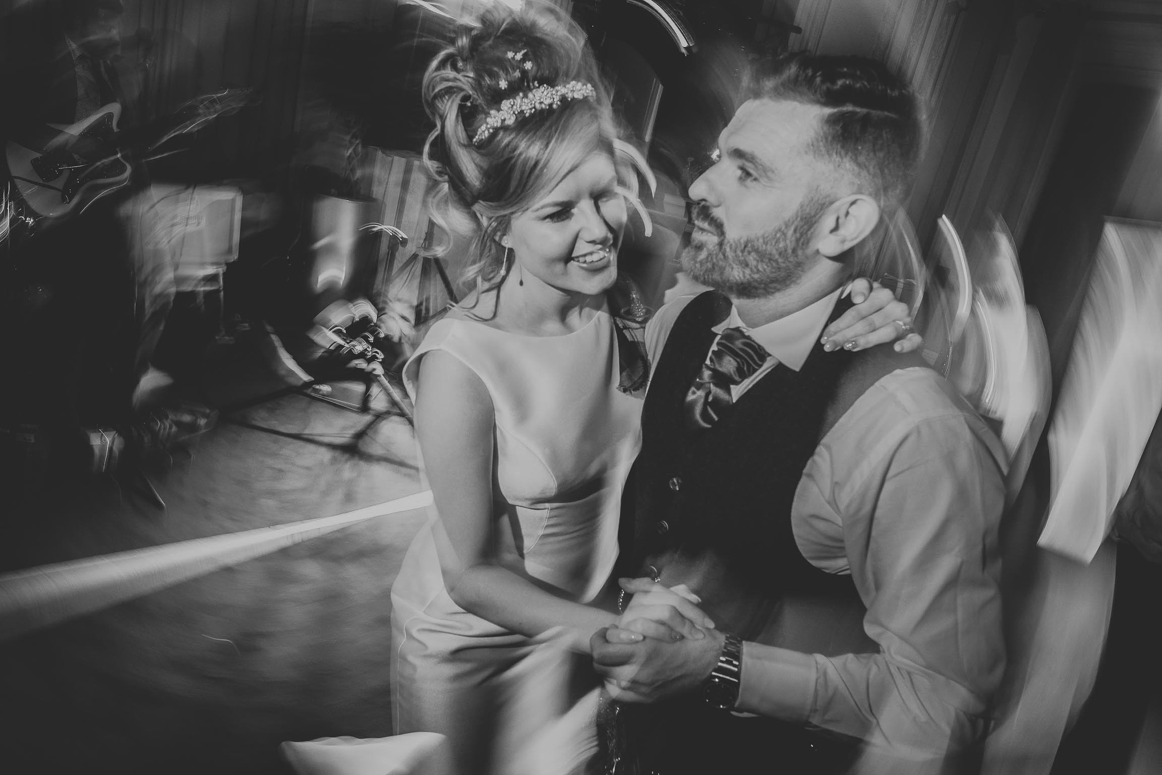 black and white image of a bride and groom during their first dance on their wedding day in Liverpool city centre
