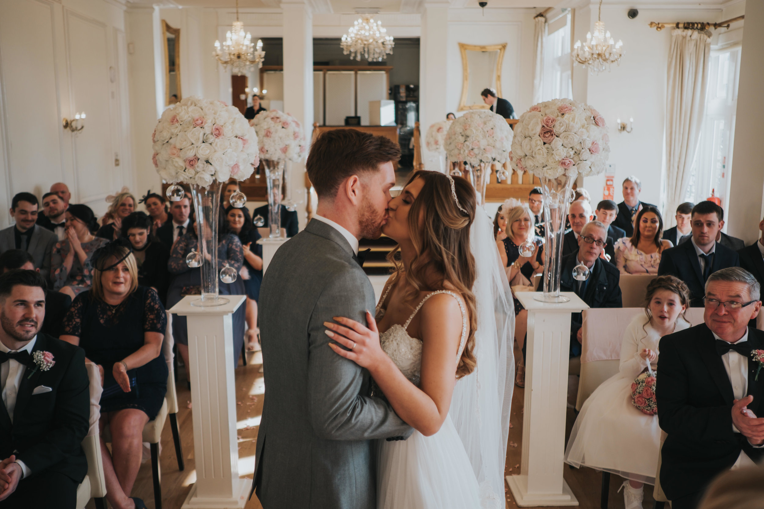 the first kiss from the bride and groom during their wedding ceremony
