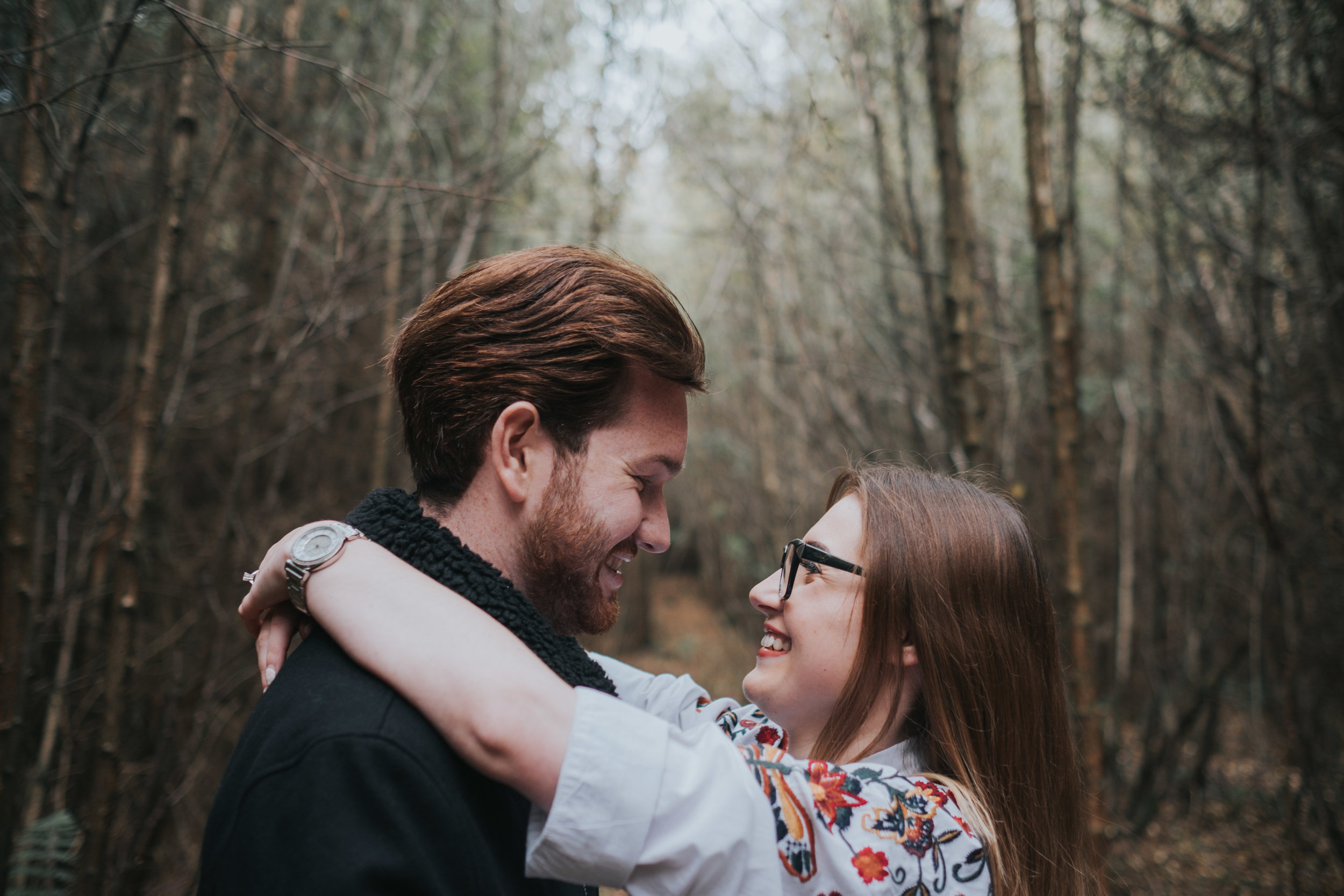 engagement photoshoot in delemere forest with the future bride and groom being happy and excited