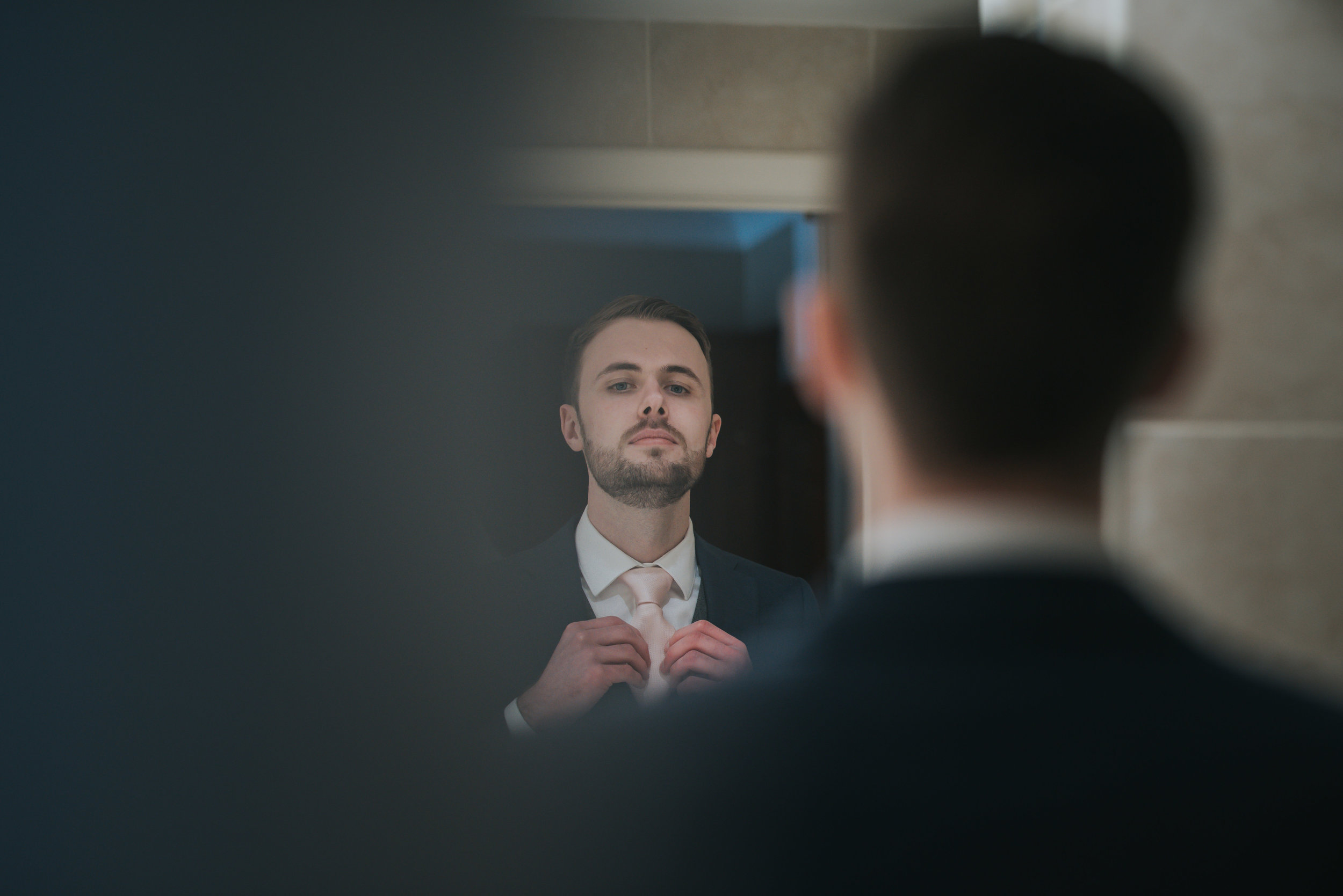 Groom getting ready for the ceremony at the Grosvenor Pulford