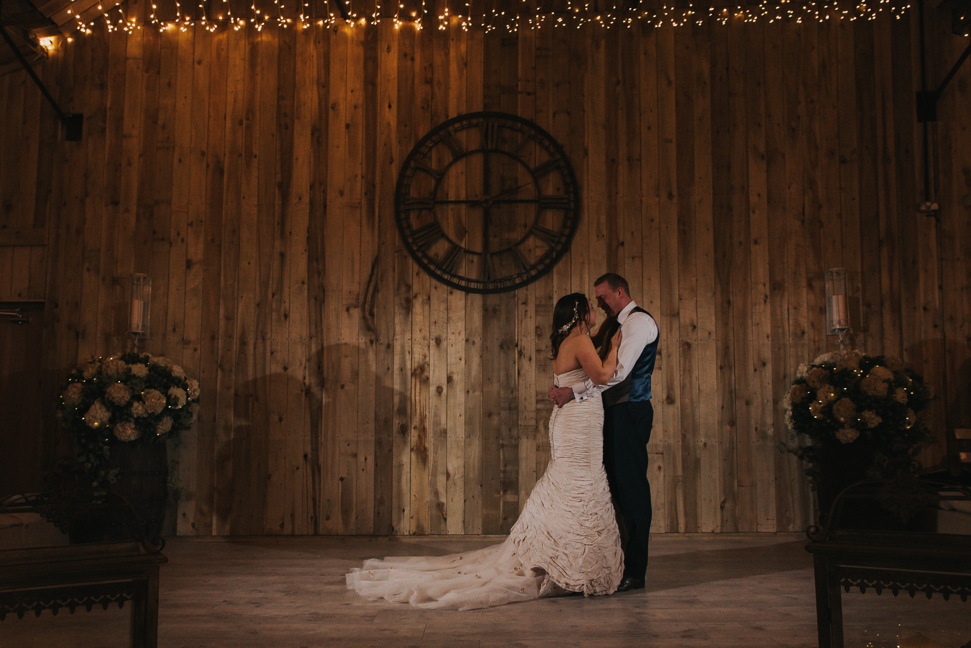 the bride and grooms first dance on their rustic wedding day at Alcumlow Hall Farm