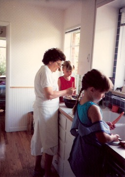 My sister's in the pigtails, I'm in the braid. Whipping up something tasty with Grandma. 1990-something, our kitchen in Denver