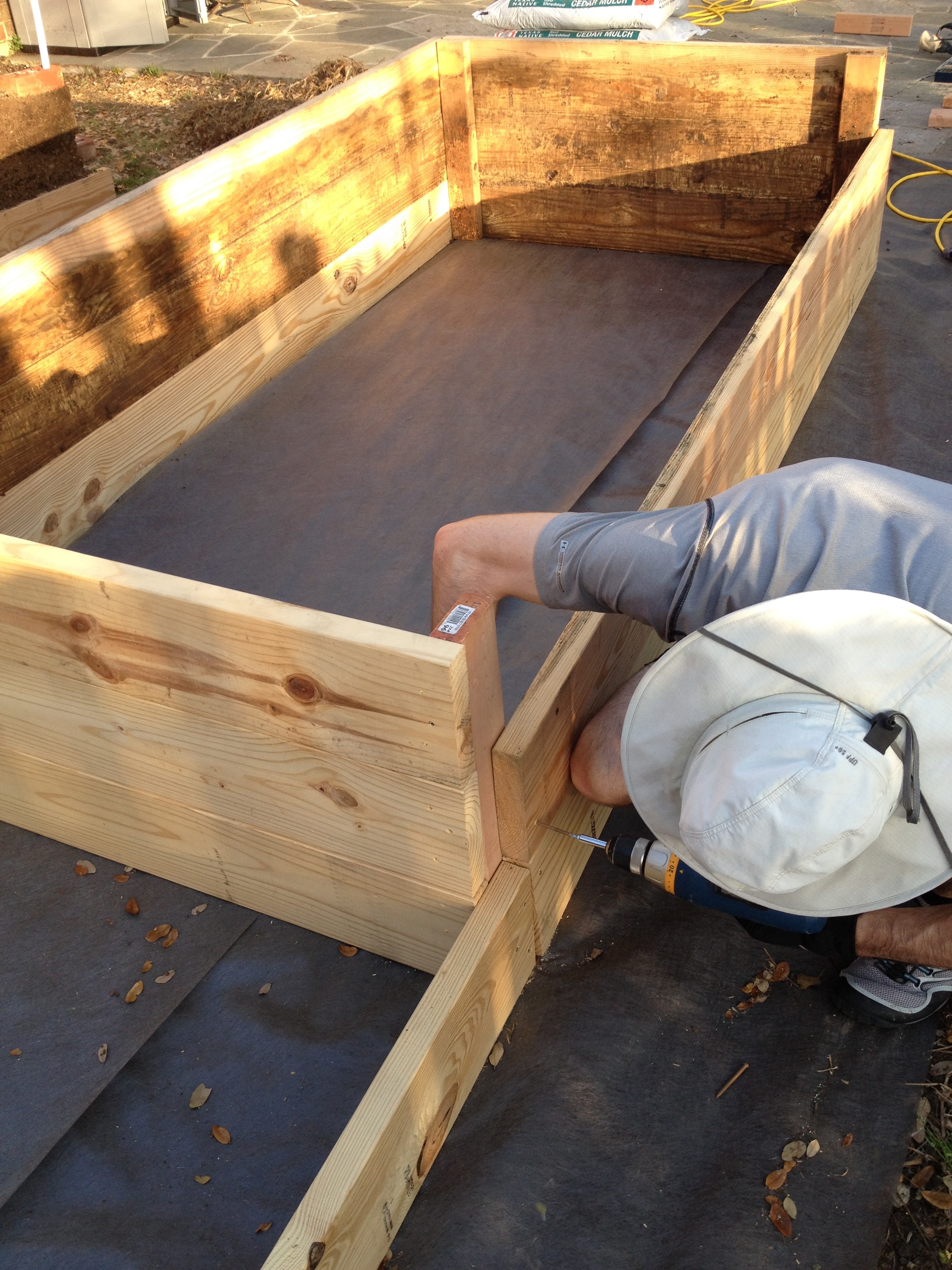 Hubby building the wicking bed