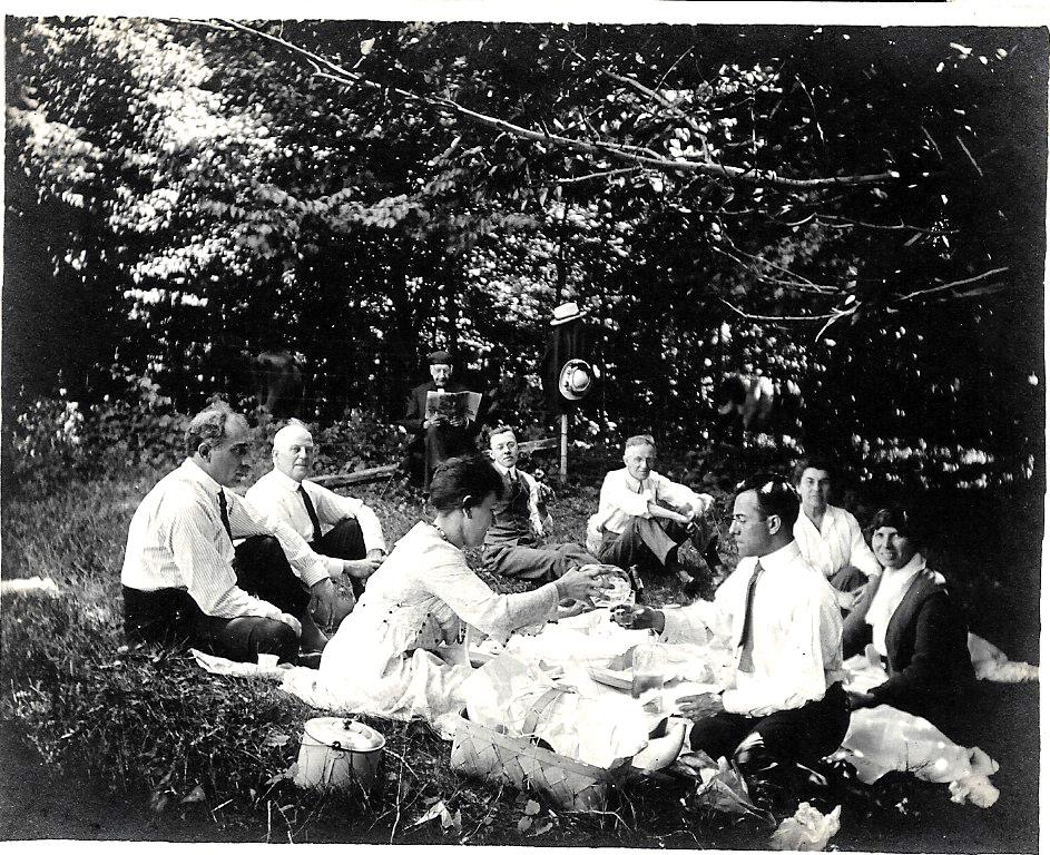 "July 4, 1918. Great-Grandpa George (front right, holding out his glass) wrote on the back of this shot, ""On the Goodwin Road"" and then carefully listed out the names of each and every person in the photo, in nice black ink. Photography was Great-Grandpa's (shown here during his college days) big hobby, and he documented everything nicely, thank heavens."