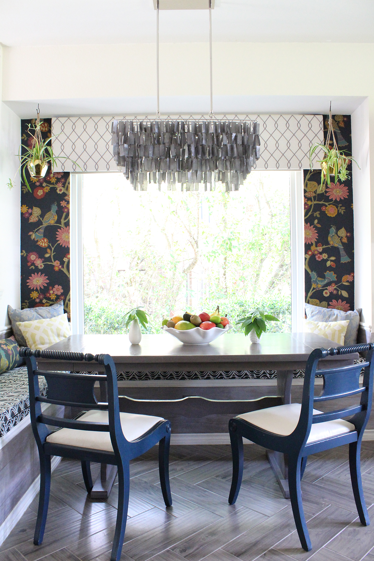 Breakfast nook featuring fabric wallpaper, capiz chandelier and herringbone tile floors by Kristin Laing Designs