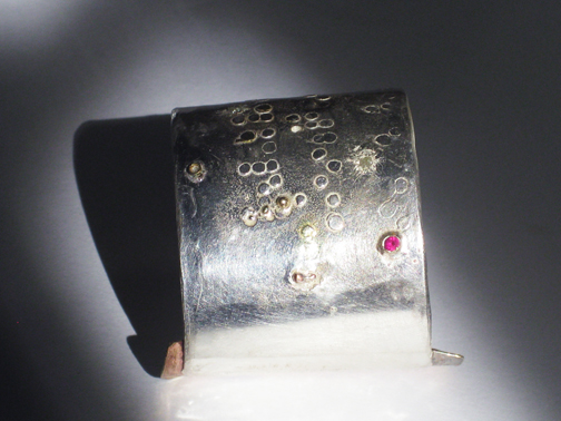 Braille series Cuff- Sterling silver brass, 18kt gold and ruby $450