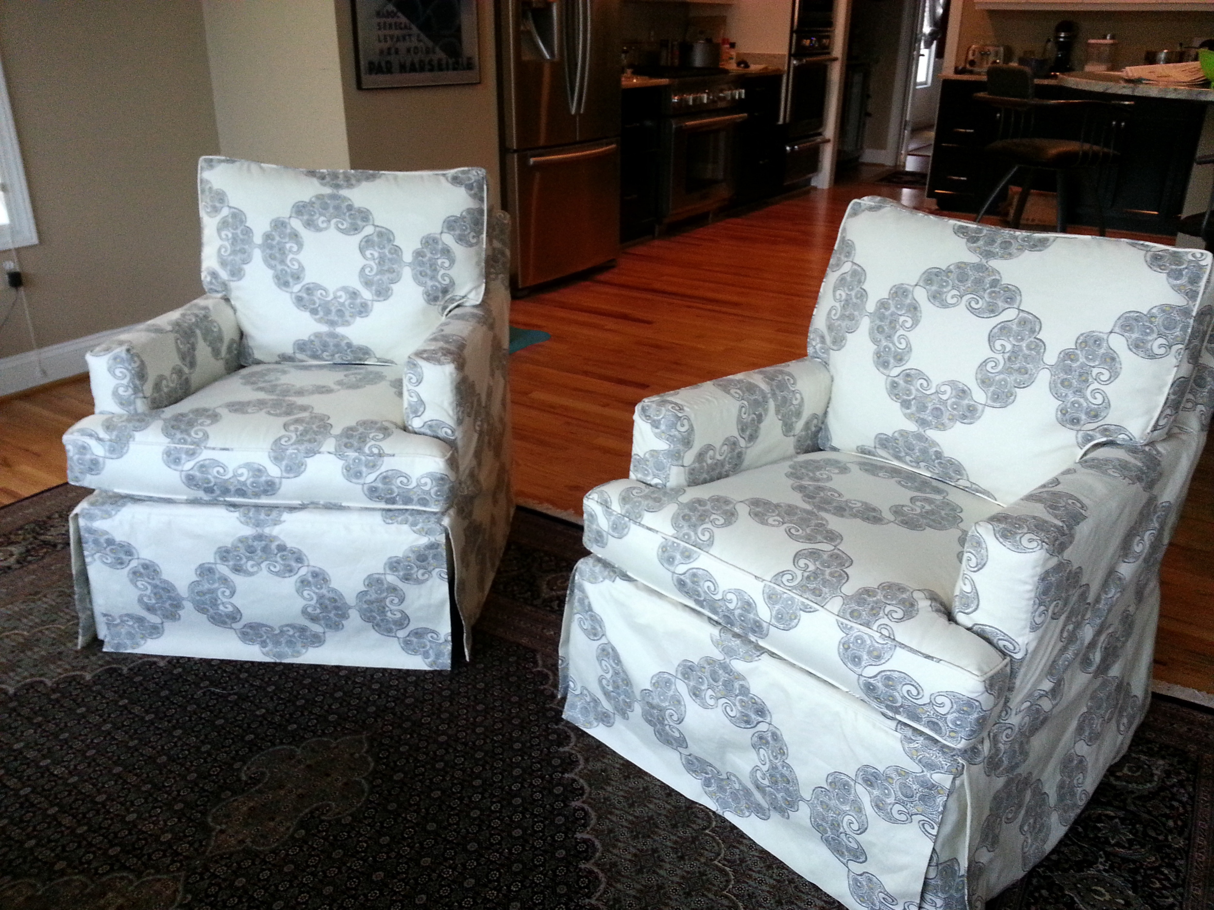Slipcovers made in John Robshaw fabric.