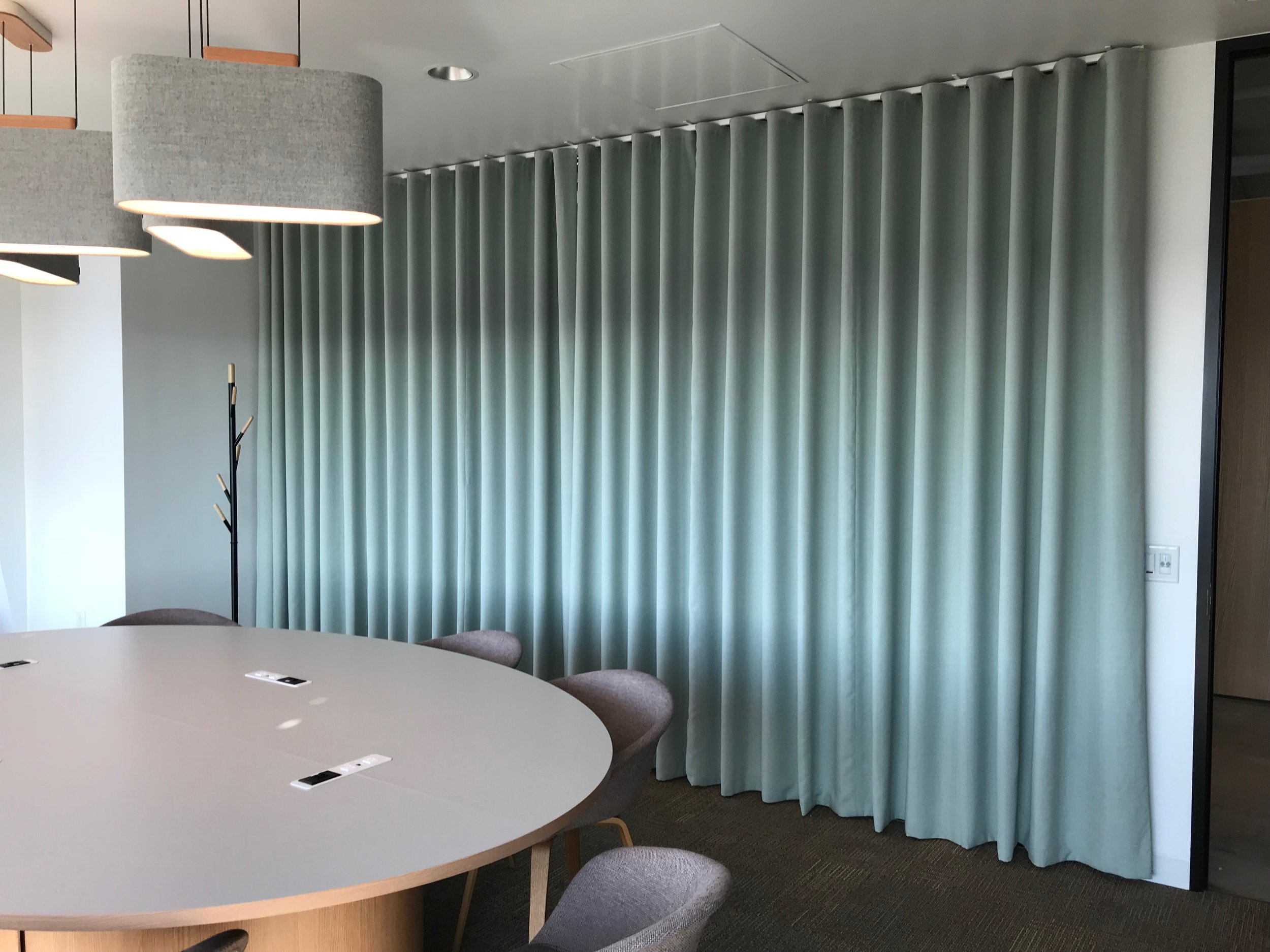 Custom double sided draperies for a commercial space in Northern Virginia, designed and installed by Home by Eva