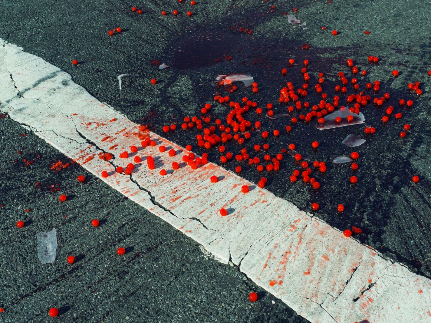 CHRISTOPHER ANDERSON, CHERRIES SPILLED ON CROSSWALK, NEW YORK CITY, USA, 2014