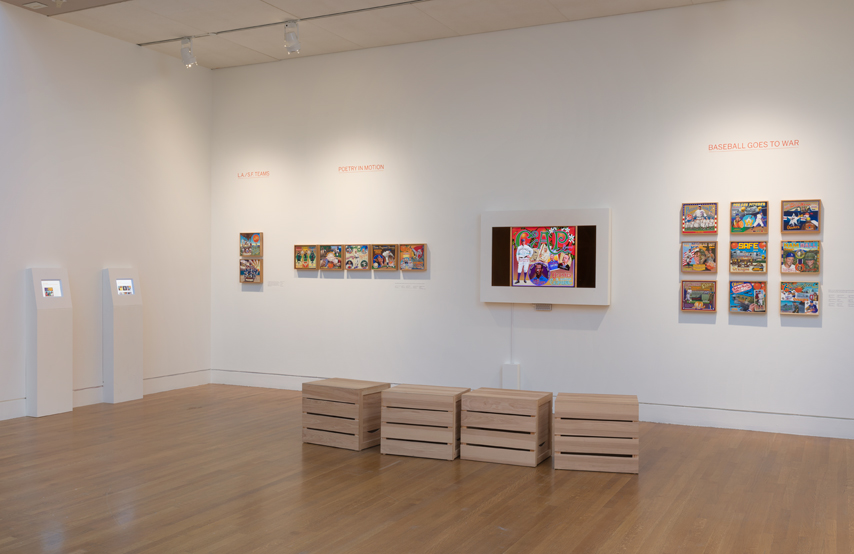 The two small screens at left featured   images of all paintings   in the exhibition, along with   text by Albert Kilchesty