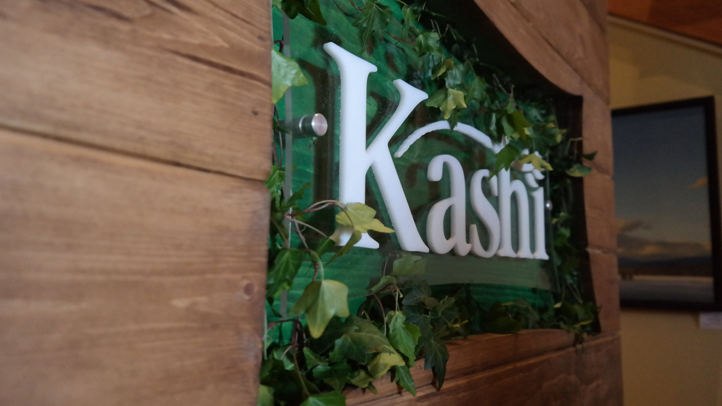 Branded custom living wall designed for the back of the space.