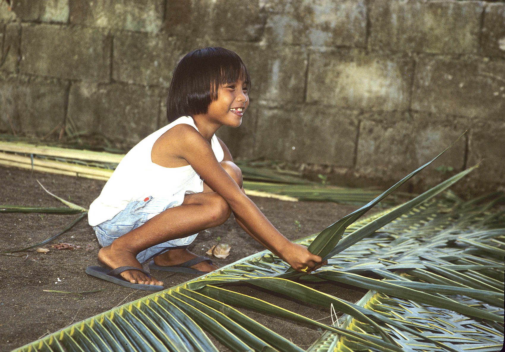Weaving palm leaves, Philippines