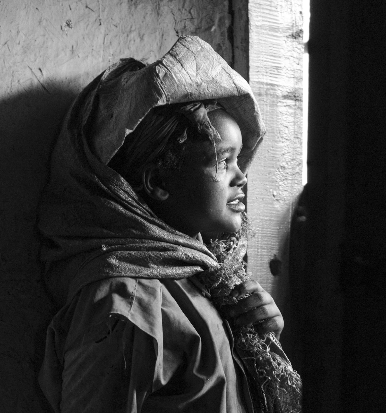 Dorze girl, waiting for rain to stop