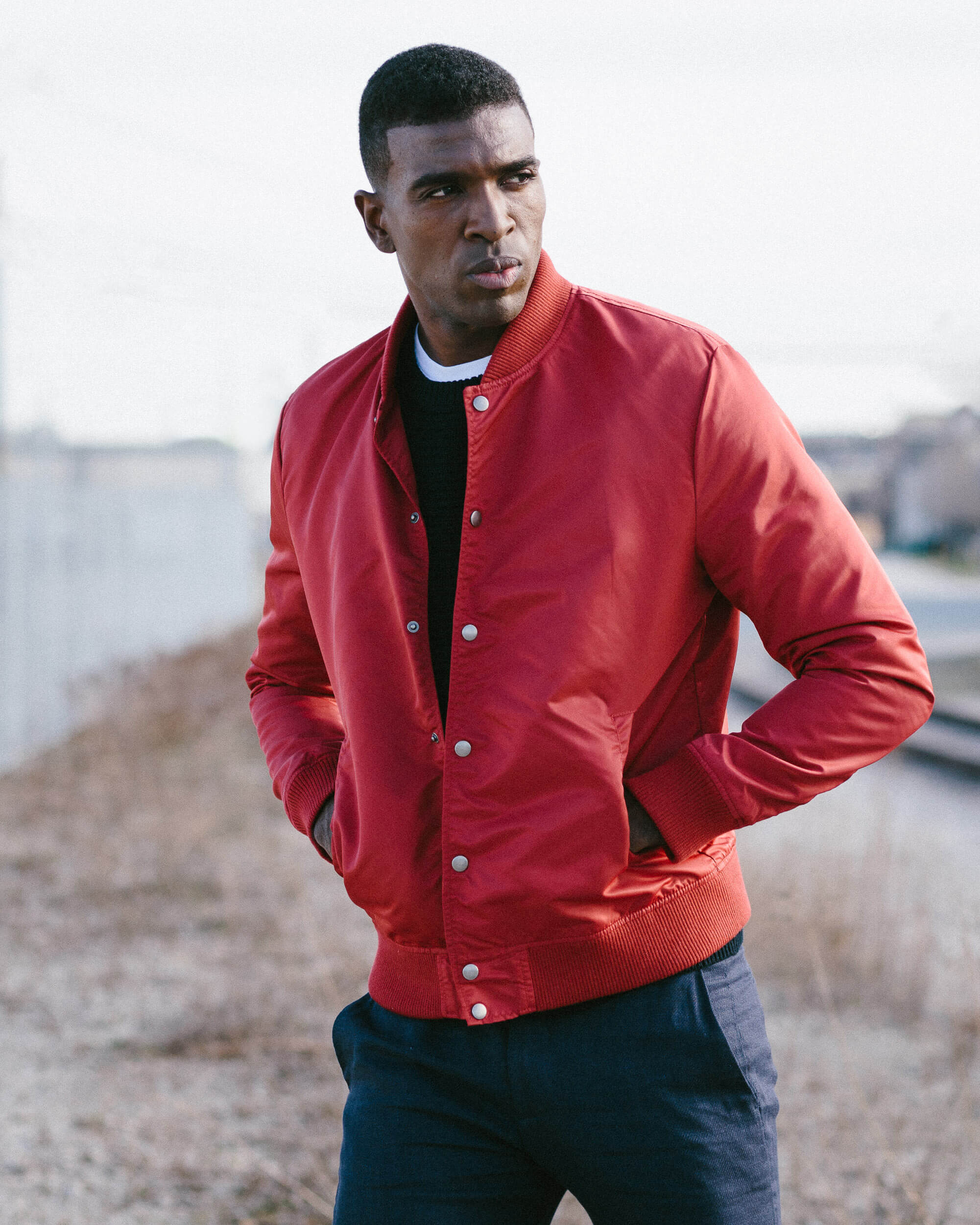 chicago fashion photography of male model wearing red jacket
