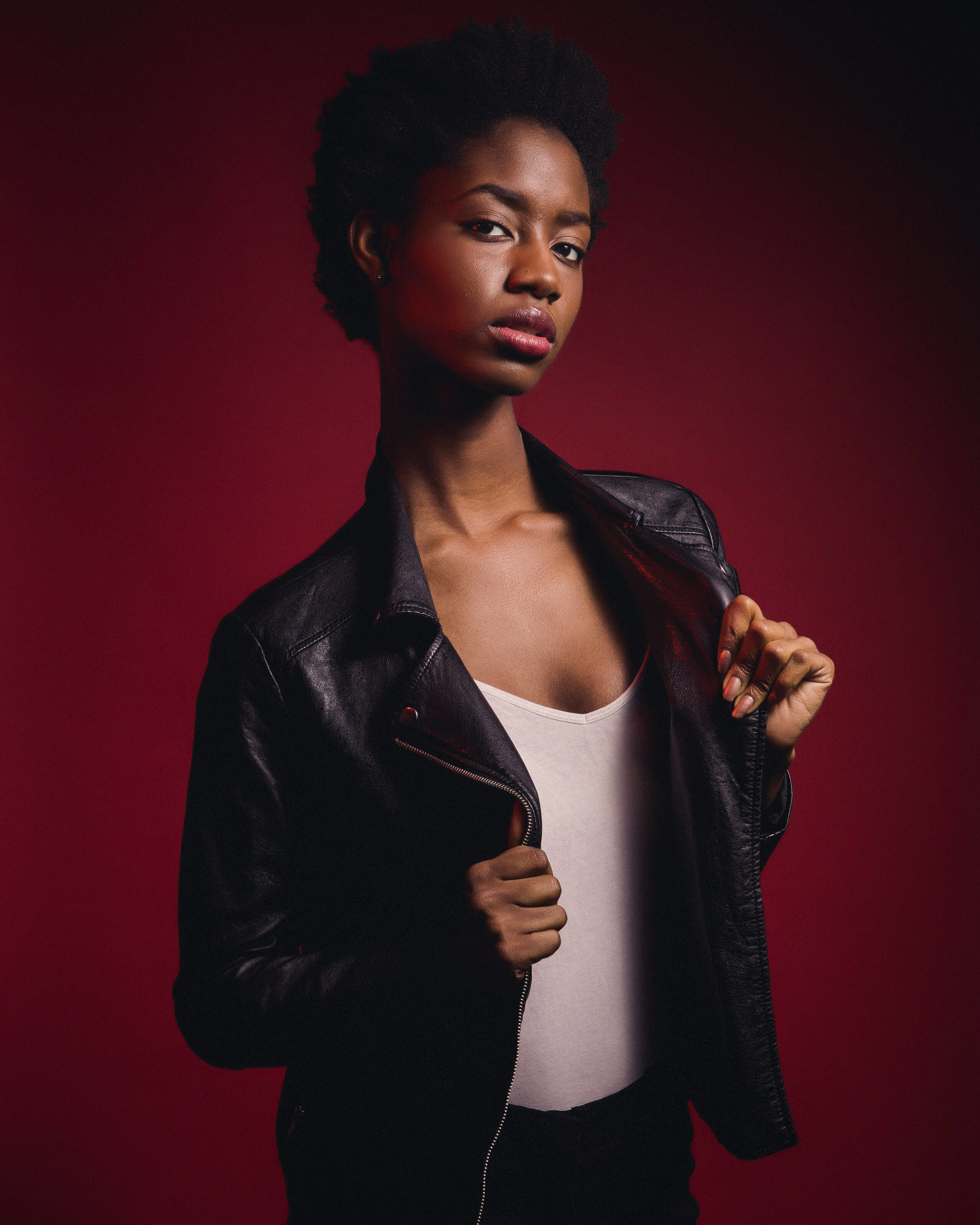 chicago fashion photography of female model wearing black jacket in photo studio