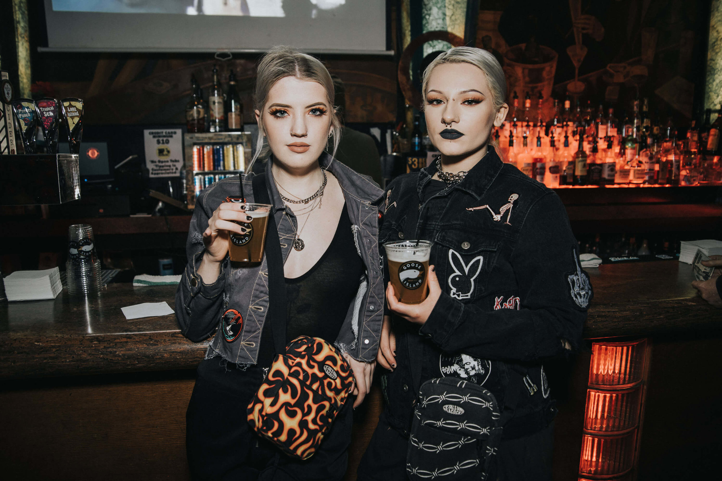 two female friends posing with goose island beer