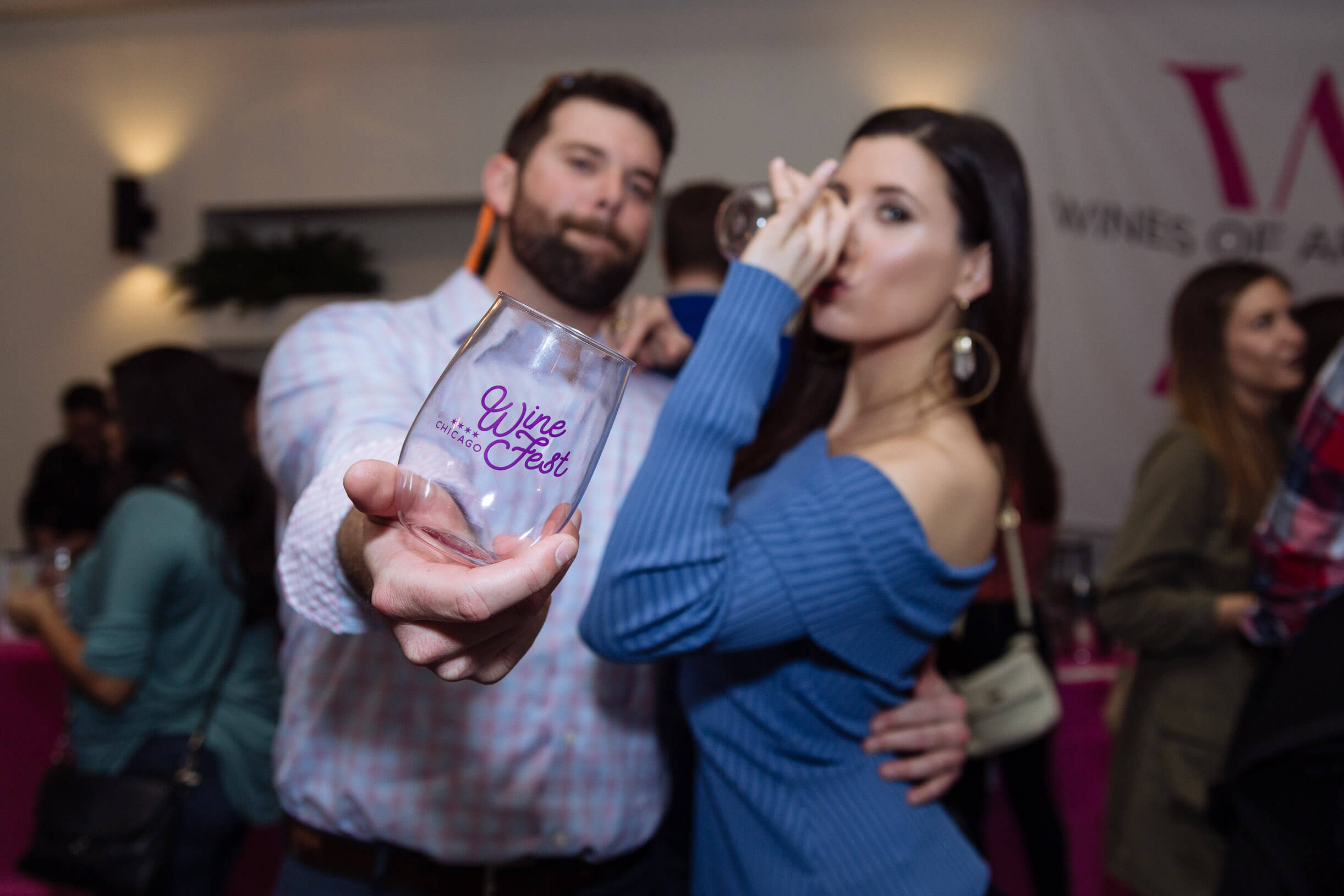 man with woman holding out chicago wine fest cup