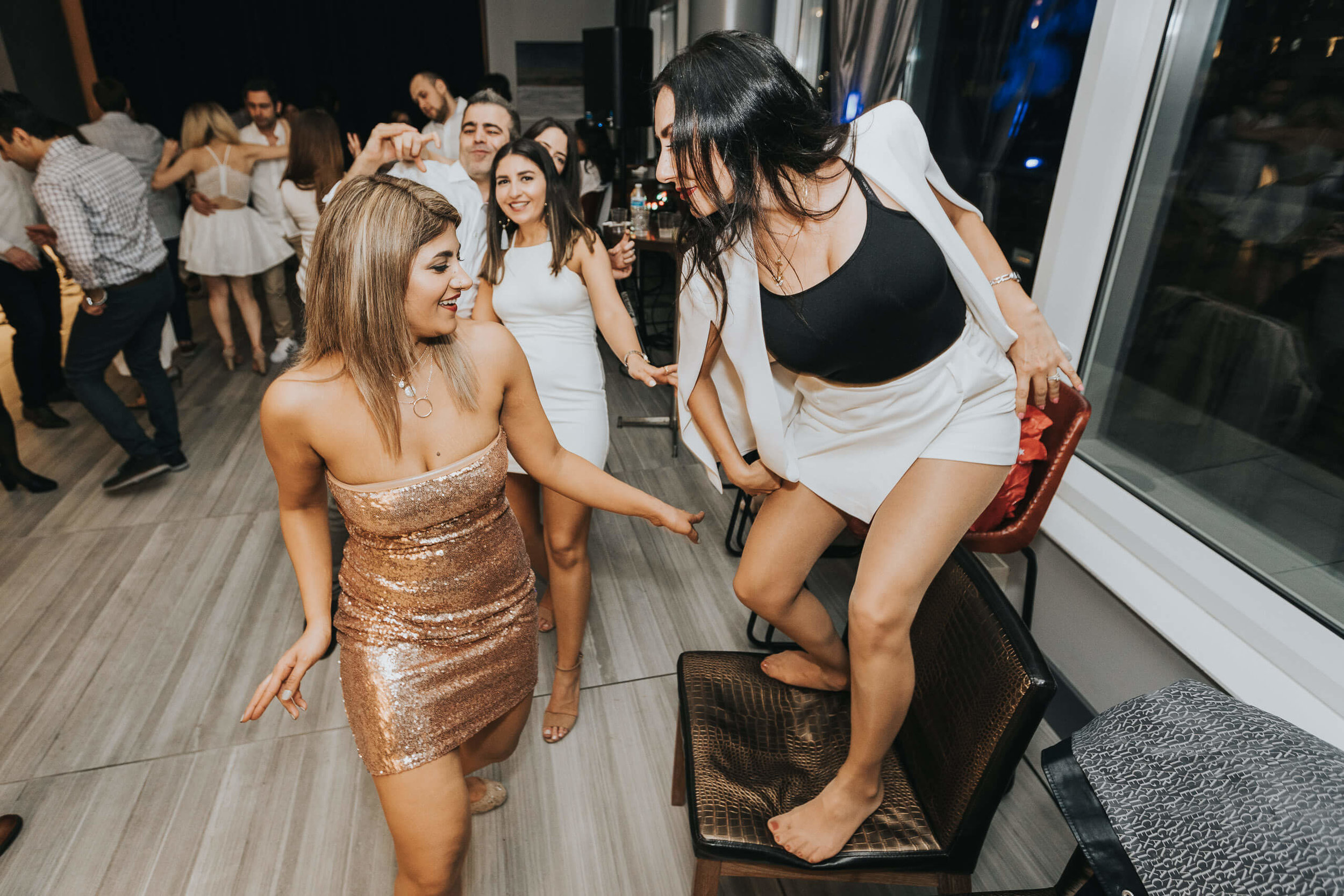 two women dancing with each other at birthday party