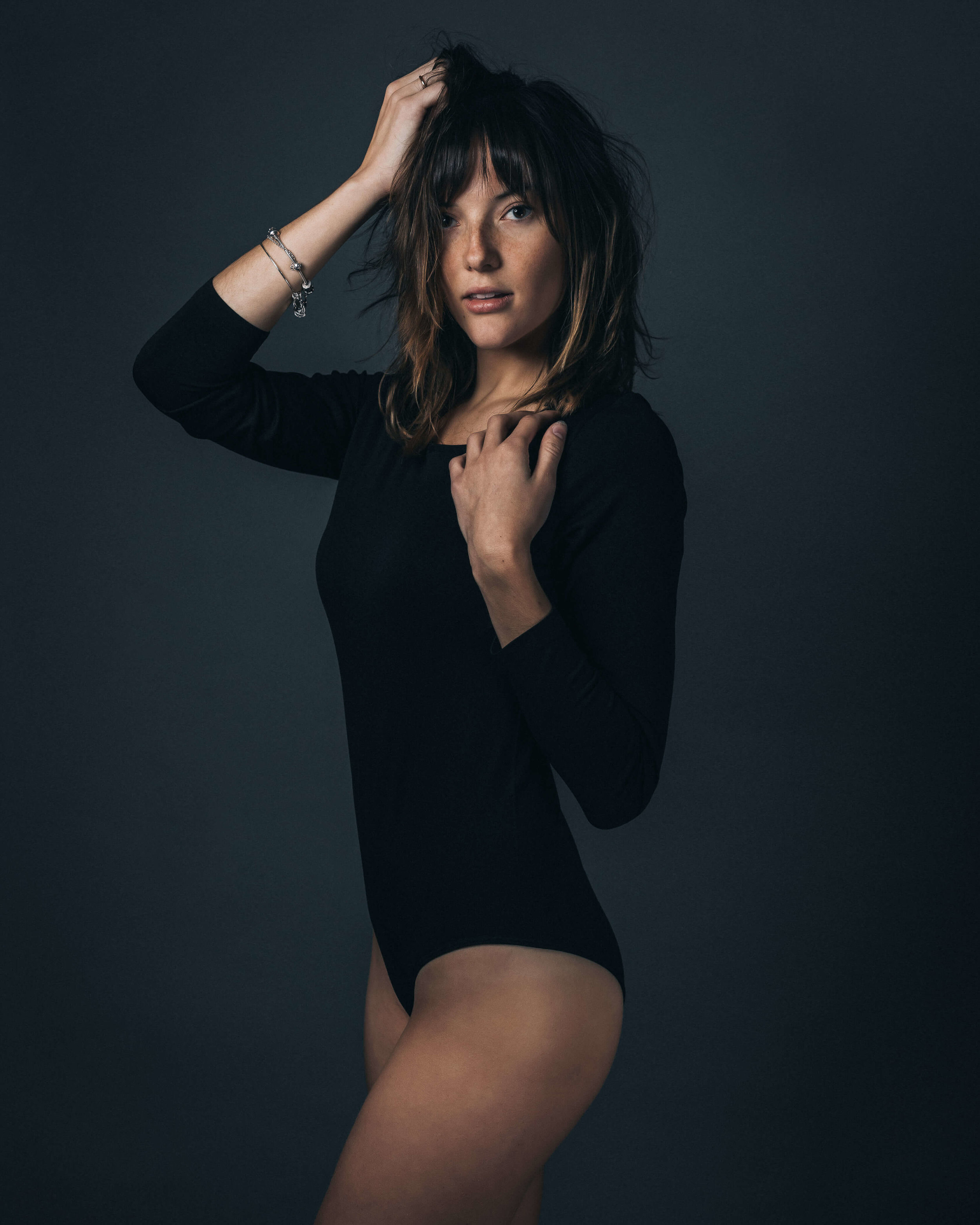 studio portrait of female model in black unitard