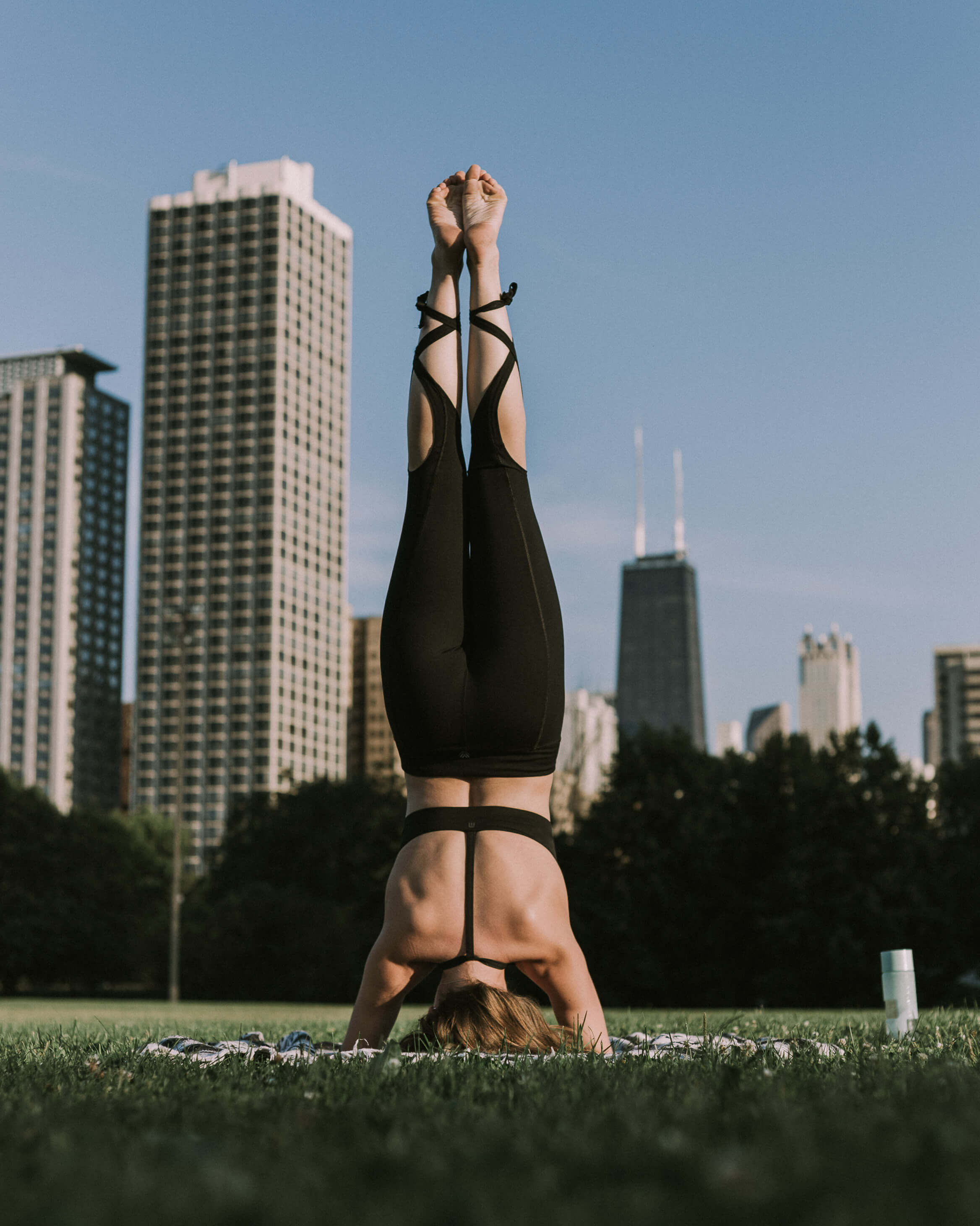 female yoga athlete posing in chicago park