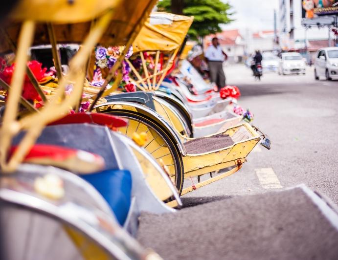 Row of trishaws in Phnom Penh