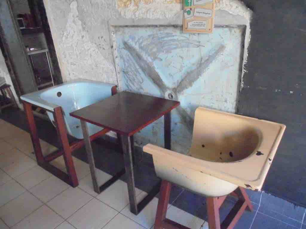 Old bath used as chairs in Cafe Kuching