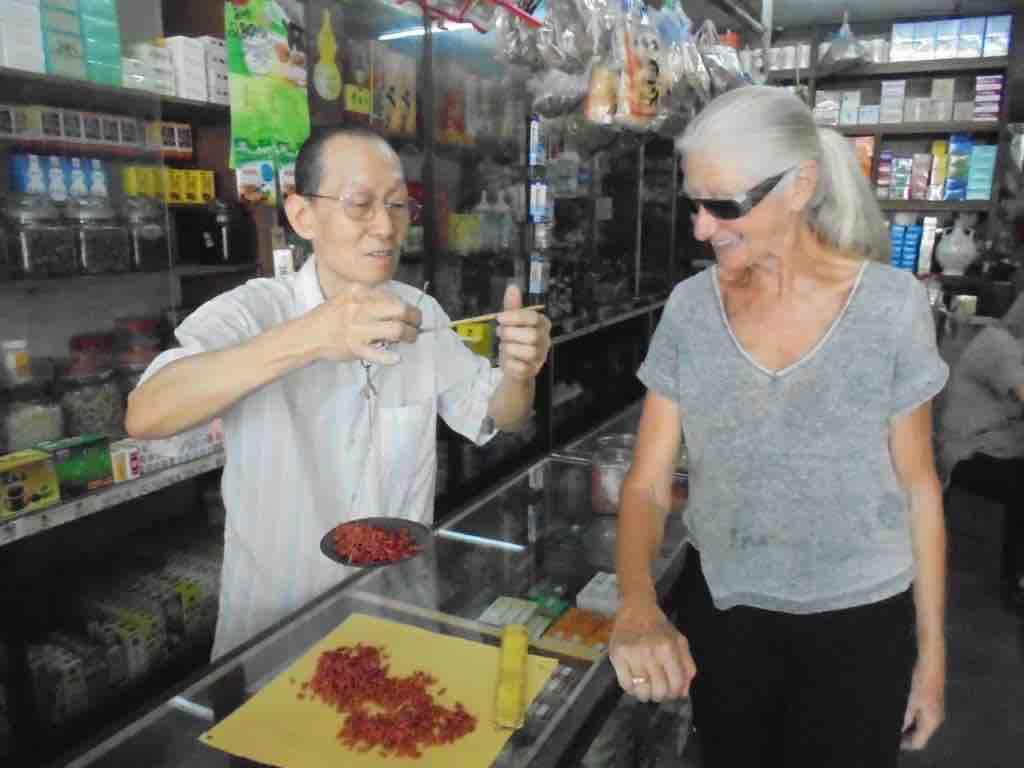 Father weighs Goji Berries