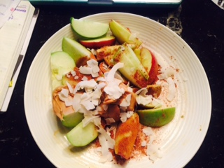 Granny Smith apple with almond butter, unsweetened shredded coconut and ground cinnamon
