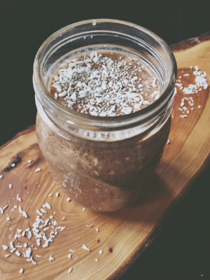 Banana French vanilla (overnight) oatmeal topped with chia seeds & unsweetened shredded coconut