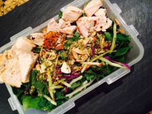 Quick and easy kale mix salad topped with grilled chicken breast and lemon seasoning
