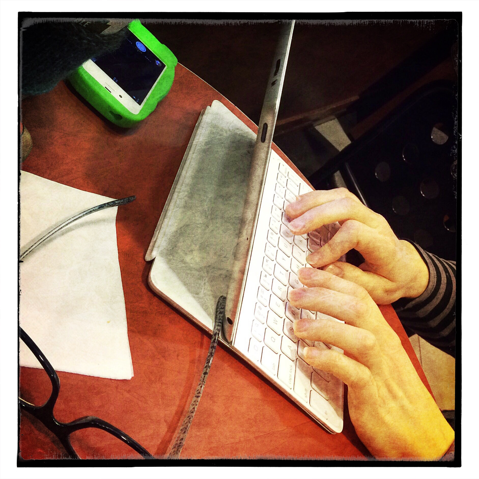 Those are DeeDee's hands on the typey thingy. Typing a shocker of a story. :)