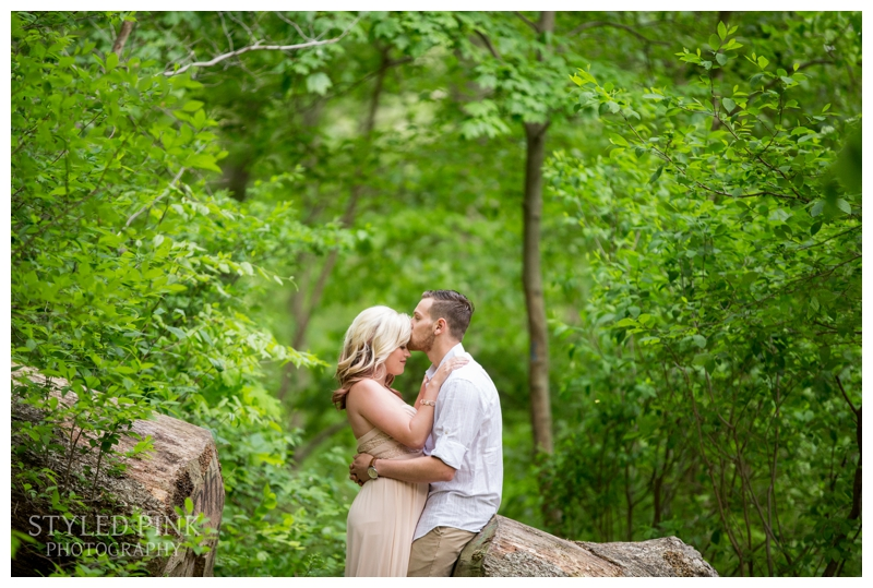 Deana braved some creepy, crawly bugs by this tree at the Wissahickon Trail in Philadelphia during their engagement session.